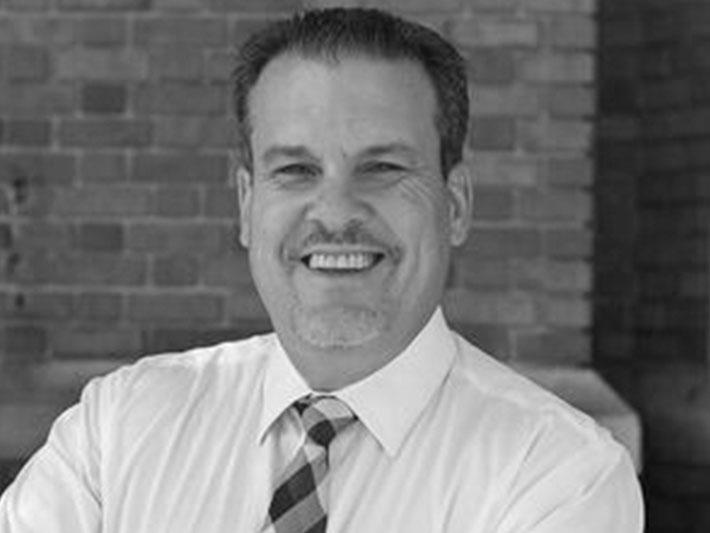Black and white headshot of Rick Pedroarias